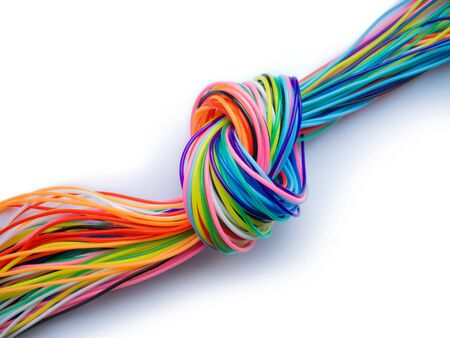 multicolored knotted plastic cables  symbol for a bottleneck in data flow or communication isolated on white background Stock fotó - 144294027