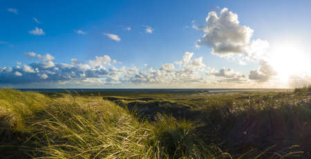 panoramic landscape with a view from the dunes to the sea during sunset on the beautiful island of Fanø in Denmark Stock fotó - 151877776