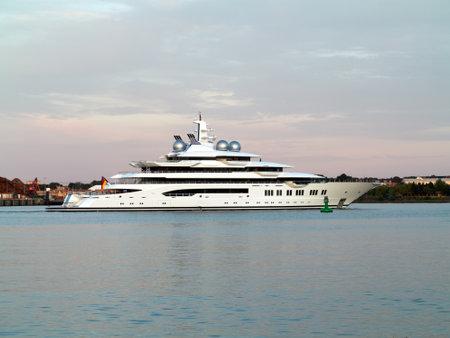 Kiel, Germany, June 28, 2016: 106 m Megayacht Amadea - former project name Mistral, built by Lürssen Körger - during test drive into the direction of port of Kiel on the Kieler Förde in sunset