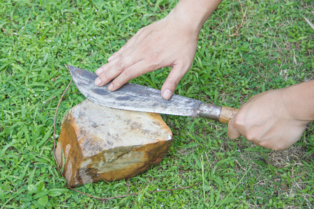 sharpening: Sharpening a knife Stock Photo