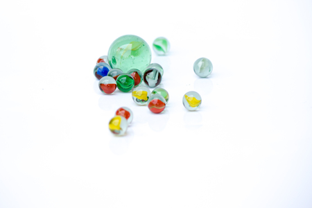 Colorful glass marbles, on white background