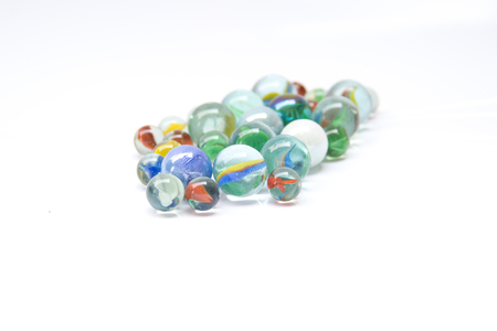 Colorful glass marbles isolated on white background Foto de archivo