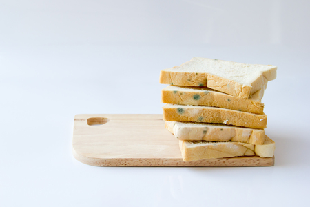 bread that has expired on wooden background