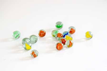 Colorful glass marbles isolated on white background Stockfoto