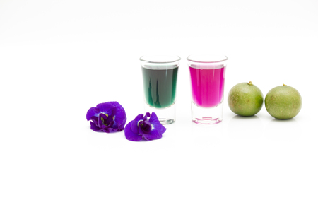 Thailand fresh healthy herbal beverage An-chan juice with lemon juice (butterfly pea flower)on white background.