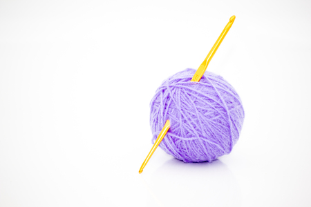 Yarn and crochet hook on a white background. 版權商用圖片