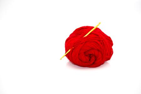 Yarn and crochet hook on a white background. 免版税图像