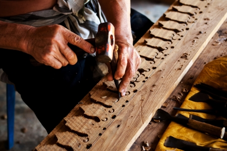 carpenter's sawdust: Sculptor is carving wood