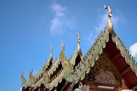 Gable apex emblazoned on the roof of the temple Thailand photo