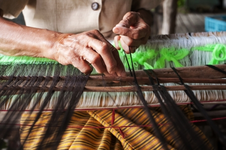Process of weaving, dyeing, weaving ancient Thailand as silk photo