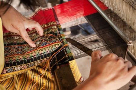 Process of weaving, dyeing, weaving ancient Thailand as silk Stock Photo - 23831096