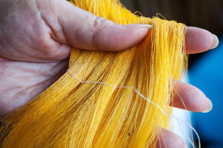 Process of weaving, dyeing, weaving ancient Thailand as silk Stock Photo - 23831053