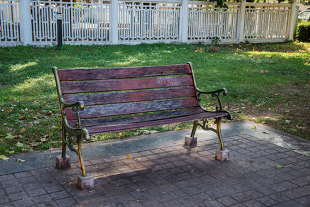 Wooden bench center of the park photo
