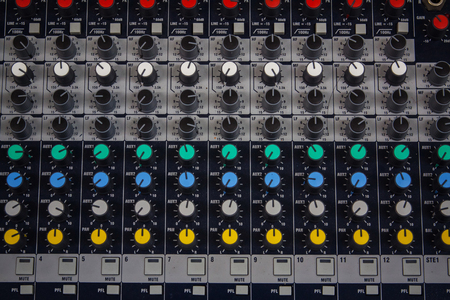 Buttons and tabs in various parts of the audio controller photo