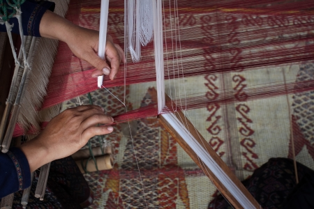 Process of weaving, dyeing textile materials used in making dye nature of ancient Thailand as silk photo