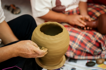 Traditional pottery pots by hand photo