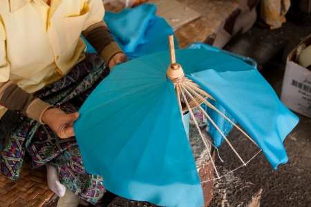 How to make the process umbrella made of paper   fabric  Arts and crafts of the village Bo Sang, Chiang Mai Thailand  photo