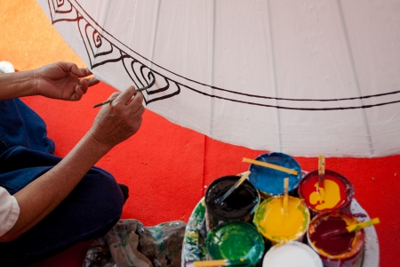 bo: Coloring paints umbrella made of paper   fabric  Arts and crafts of the village Bo Sang, Chiang Mai Thailand  Stock Photo