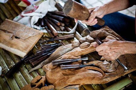 requires: The wood carving which requires skill, experience and imagination Stock Photo
