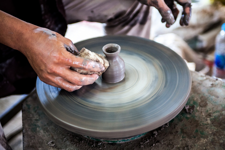 requires: The Clay sculpture carving which requires skill, experience and imagination Stock Photo