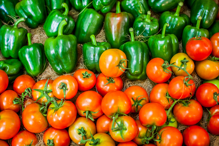 Bell pepper and tomatos, beautiful colors are arranged.