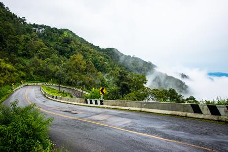 Road and sea fog Doi Ang Khang, Chiang Mai, Thailands highest mountain.