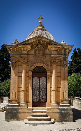 single family: The old single family crypt on a blue sky background. Santa Marija Addolorata cemetery. Paola. Malta.