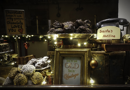 shopfront: Christmas showcase with sweets in vintage style. Christmas sweets. Selective focus. Natural light. Stock Photo