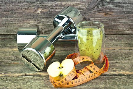 vitamine: The concept of weight loss, Green smoothie, half of apple and measrure tape