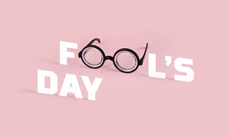 Greeting card for April Fools day. Funny goggles with round glasses on pink background and the word FOOL, concept, copy space