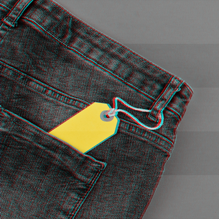Monochrome with glitch signal concept of sale black Friday and cyber Monday discount yellow tag in jeans pocket isolated on gray background. Copy space, flat lay, square format