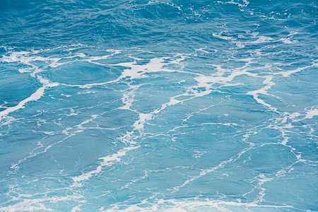 Natural pattern of blue sea surface water, texture natural light and waves