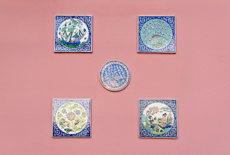 Hand-painted ceramic tiles and rosettes with mythic plots are a symbol of Sicily, locals decorate their houses with ceramics Stock Photo