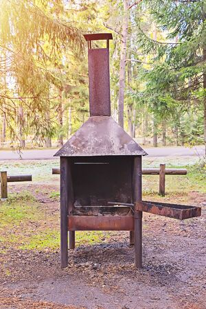 Environmentally friendly place for grilling in forest. Specially equipped picnic area for people in forest near the lake