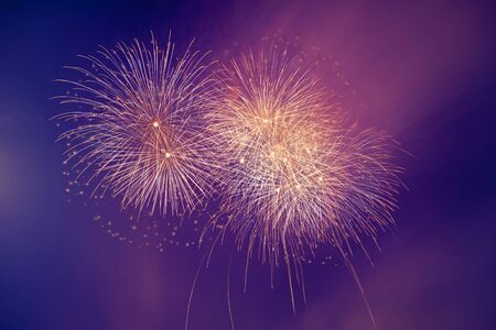 Abstract colorful beautiful fireworks salute against blue sky. Neon Holographic pattern of salute Foto de archivo - 127562969