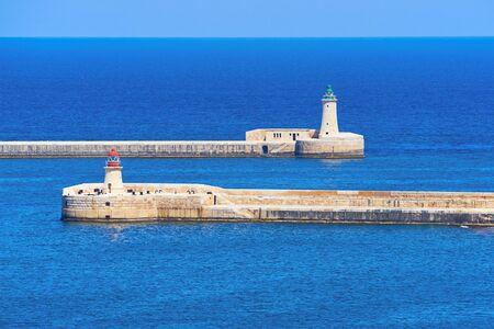 Ricasoli and St. Elmo Lighthouse at harbor in Kalkara near Valletta Grand harbor in Malta