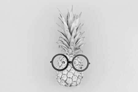 Funny pineapple face with eyeglasses in trendy black and white colors. Smart face or back to school concept 스톡 콘텐츠