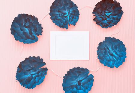 Composition with paper cuted flowers and white frame with blank for text. Template to greeting card