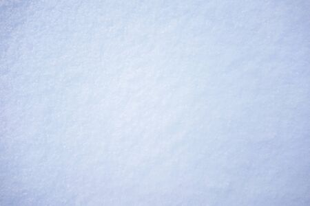 Natural texture of fresh fluffy snow on the surface, closeup, top view
