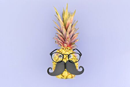 Funny pineapple face with mustache and glasses in trendy neon colors. Smart face or back to school concept