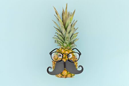 Funny pineapple face with mustache and eyeglasses on blue background. Smart face or back to school concept