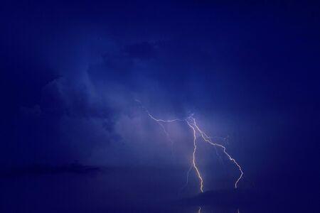 Night sky with lightning thunderstorm flash over sea. Rainy weather overlay pattern Stock fotó - 136245797