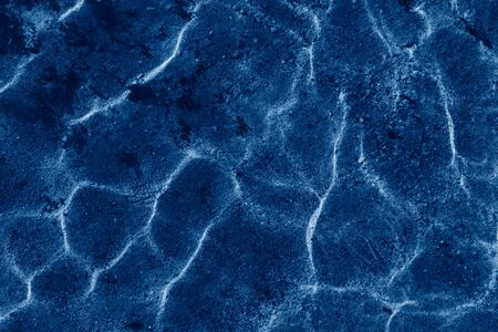 Abstract pattern Sea or ocean water caustic texture background Ultra Violet water color purple sand and sea rock. Toned image with trend color of 2020 year Classic blue. Stock fotó - 136246284