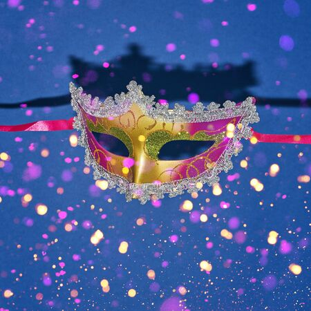 Mardi Gras masquerade mask on blue background with confetti. Venetian carnival Mardi Gras party bright festive decor. Invitation, banner, card, poster, flyer