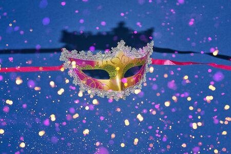 Mardi Gras carnival masquerade mask on blue background  confetti. Mardi Gras day party bright festive decor. Invitation, banner, card, poster, flyer Stock fotó