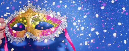 Mardi Gras carnival masquerade mask on blue background with confetti, copy space. New Orleans carnival Mardi Gras day party bright festive decor. Invitation, banner, card, poster, flyer