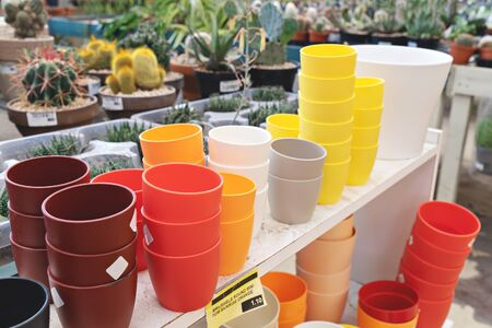 Gardening shop stands with colorful flower pots. Preparation home gardening concept