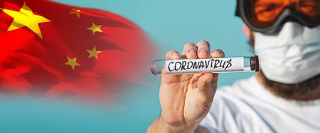 Banner man in protective goggles and surgical mask holds hand abstract laboratory tube with coronavirus 2019-nCov. Concept of spread of Chinese Coronavirus 2019-nCoV virus around world Stock fotó