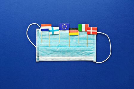 Protective surgical mask and flags of countries that have confirmed cases of coronavirus. Concept of global spread of Coronavirus Novel 2019-nCoV virus Stock fotó