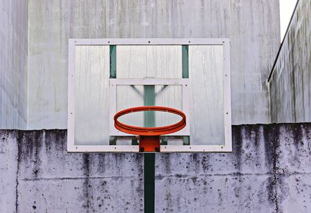 Basketball board with hoop without net in backyard outdoor in grunge style, minimal, copy space